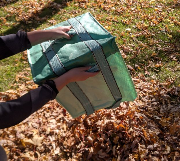 The side and bottom handles on the Garden-Bag make emptying easy